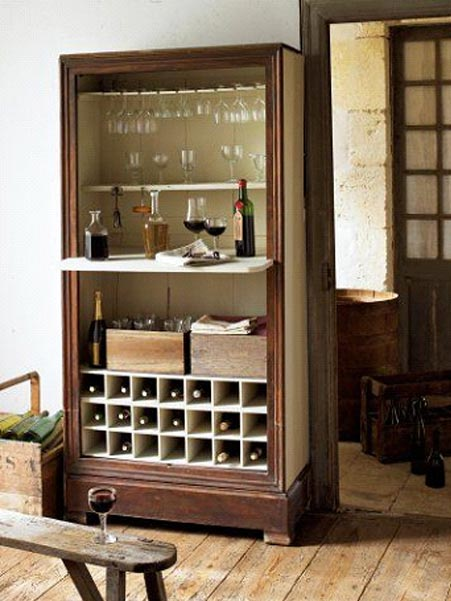 A cabinet recycled as a wine cellar