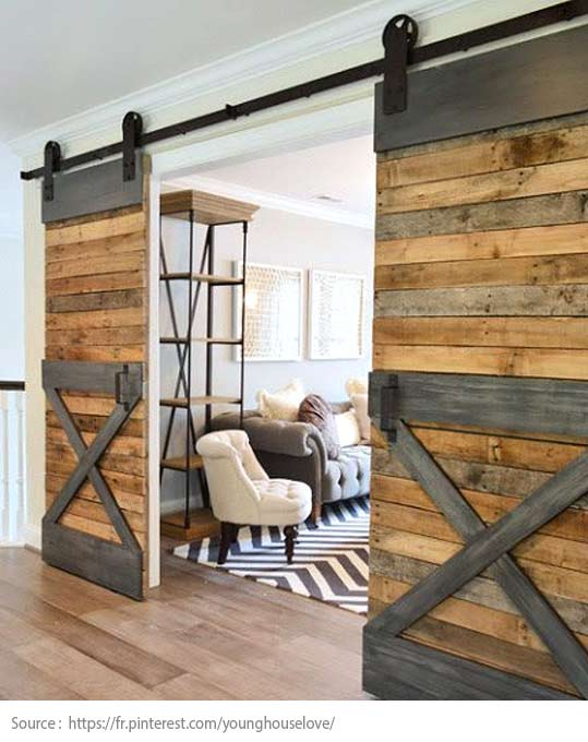 A barn door that opens onto the living room