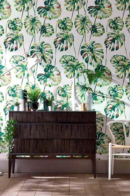 Papier peint avec des feuilles vertes